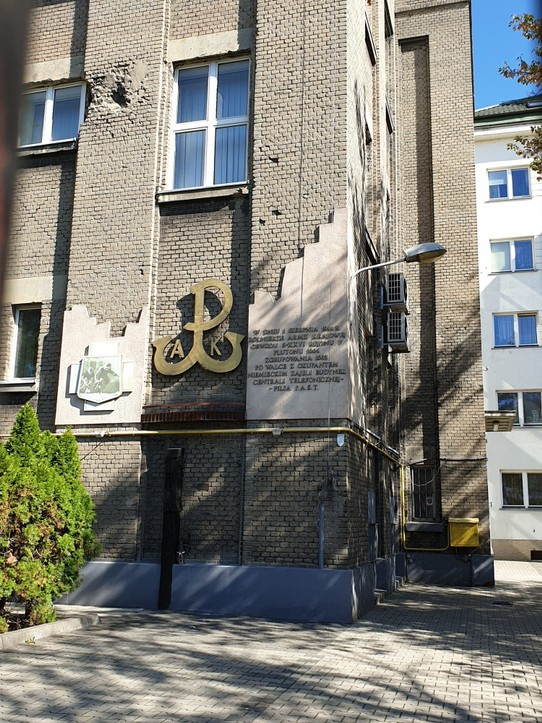 Poland - Warsaw - Telephone exchange in Praga with WWII damage and the symbol for the Polish resistance